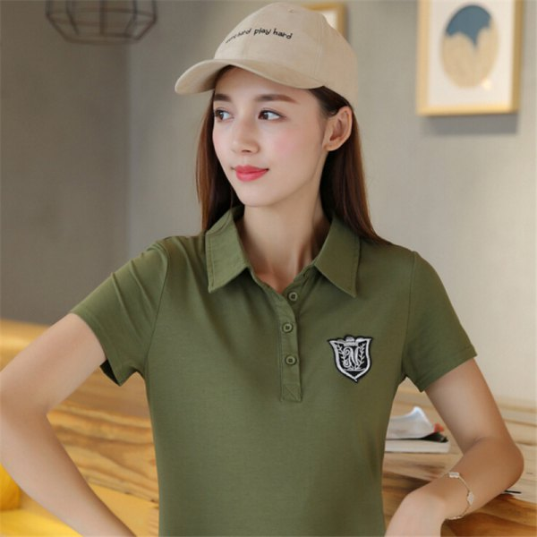 green slim fit embroidered polo shirt with light pink baseball cap