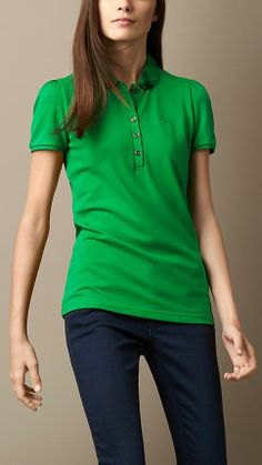 green slim fit top with dark blue skinny jeans