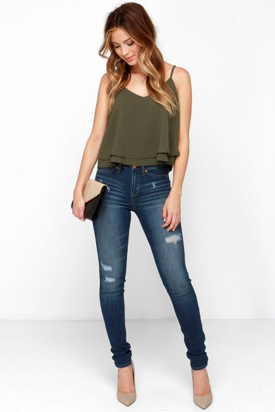 green spaghetti strap chiffon top with V-neckline and high jeans