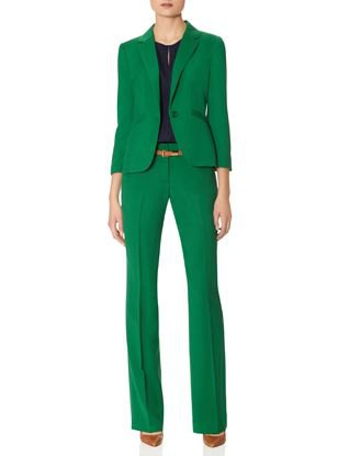 green suit jacket with high-waisted straight-leg trousers