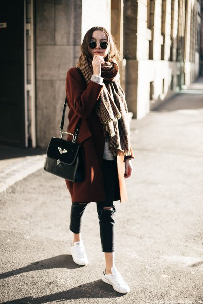 green sweater with oversized scarf and black leather pants