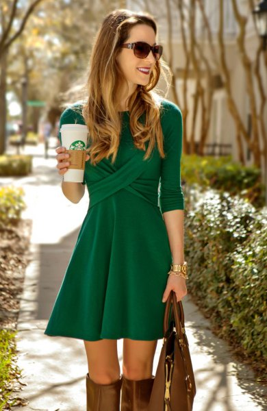 green skater cocktail dress with three-quarter sleeves and knee-high boots