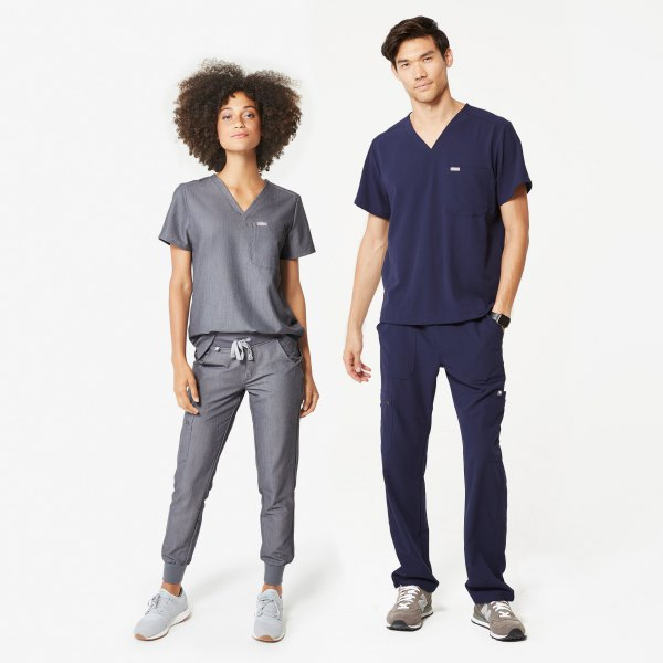 T-shirt with gray V-neck and gray trousers with tapered legs