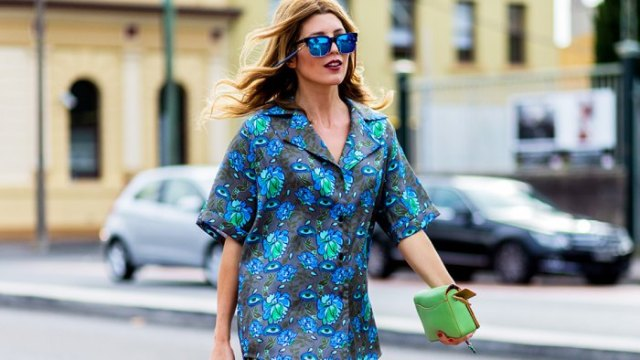 gray and blue oversized floral aloha shirt and light pink clutch