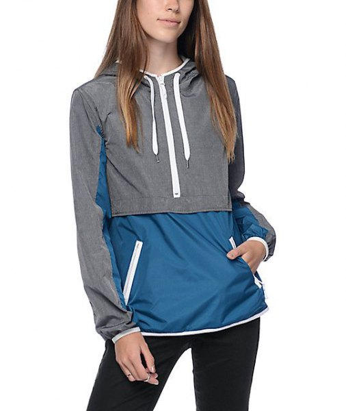 gray and dark blue color-block sweater sports jacket with dark jeans
