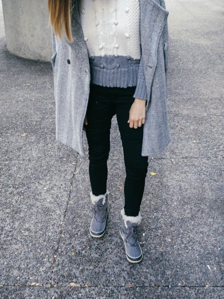 gray and white block knit sweater with black jeans