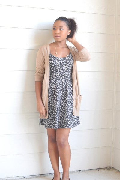 gray and white floral mini swing dress with an ivory-colored cardigan