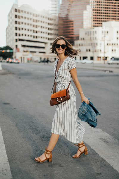 gray and white midi dress with a ruched waist and red heels