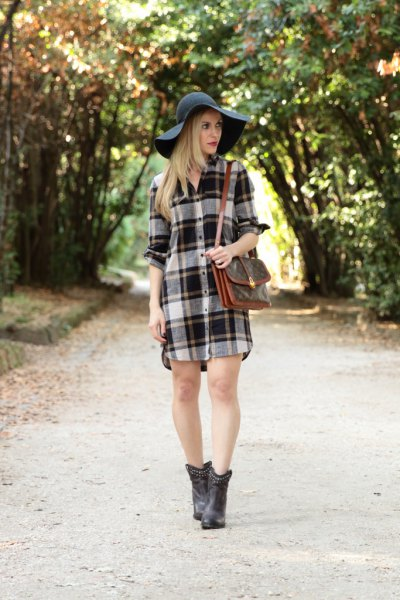 gray and white checked flannel shirt dress with black floppy hat
