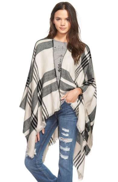 gray and white ripped plaid poncho jeans