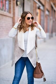 gray and white sherpa vest with striped long-sleeved t-shirt
