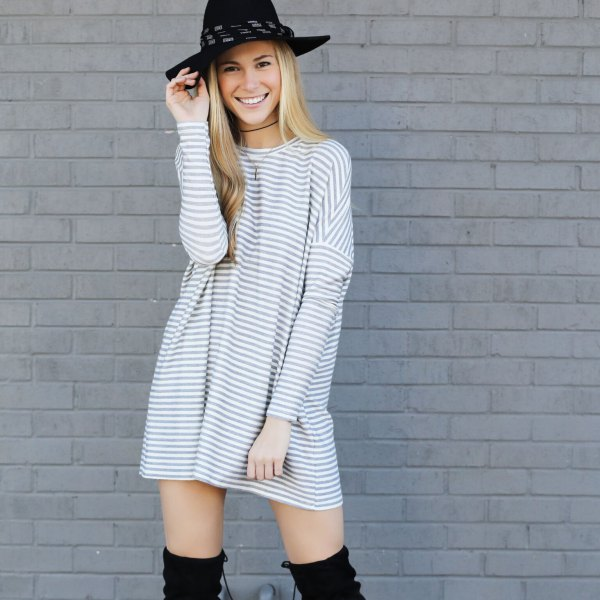 gray and white striped long-sleeved tunic dress with a round neckline and a felt hat