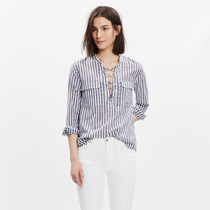 gray and white striped lace-up shirt white jeans