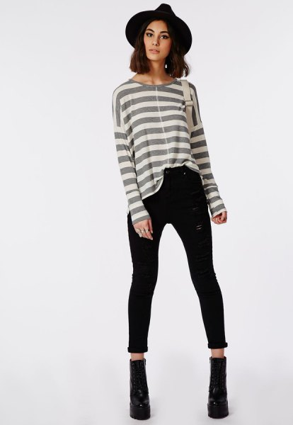gray and white striped long-sleeved T-shirt with high-waisted black skinny jeans with cuffs