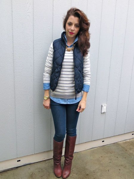 gray and white striped sweater over a light blue chambray shirt