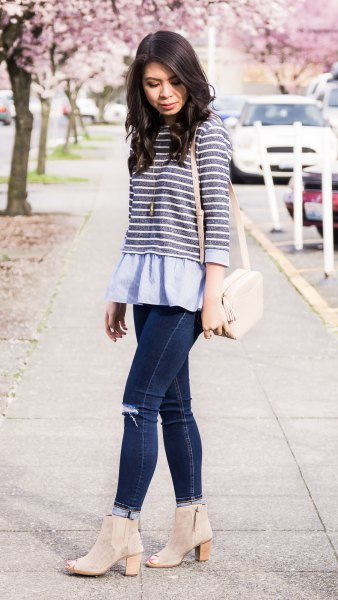 gray and white striped top over a light blue peplum blouse