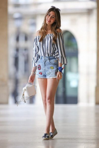 gray and white, vertical striped shoulder blouse with graphic denim summer shorts