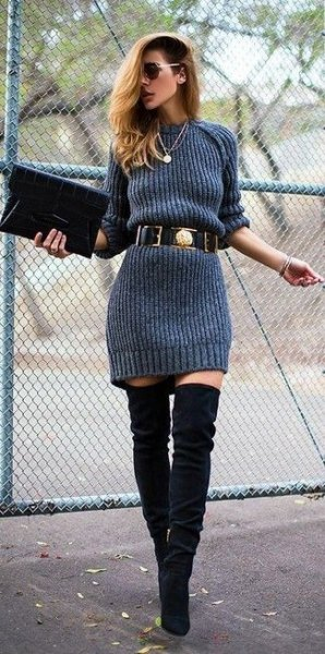 gray sweater dress with belt and overknee boots made of black suede