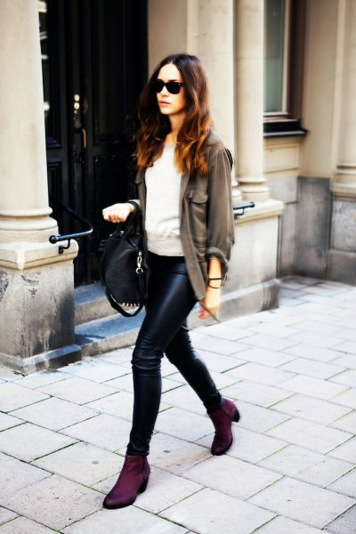 gray blazer with light gray sweater and leather pants