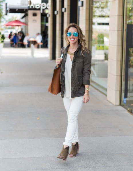 gray blazer with white blouse and cuffed jeans