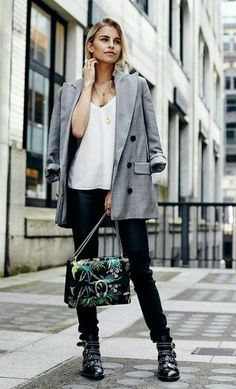 gray blazer with white chiffon blouse with V-neck and leather boots with spikes