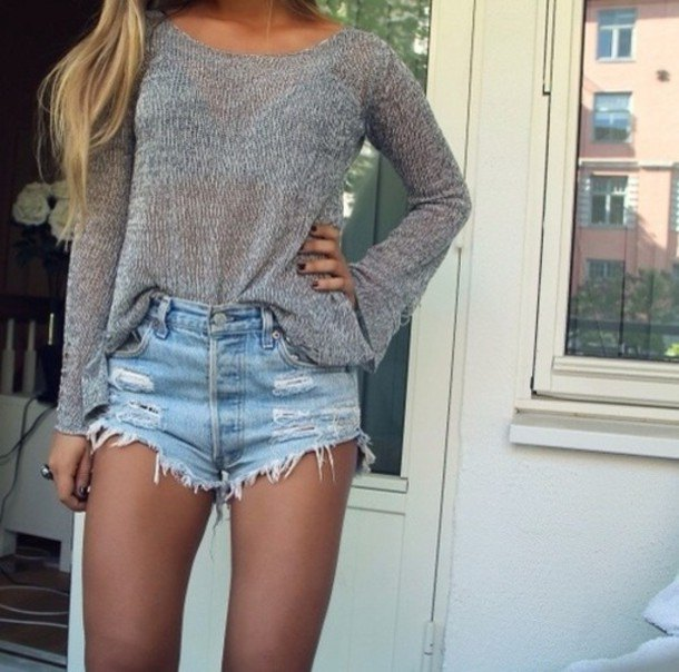 gray sweater with boat neckline and light blue, pulled-up denim shorts