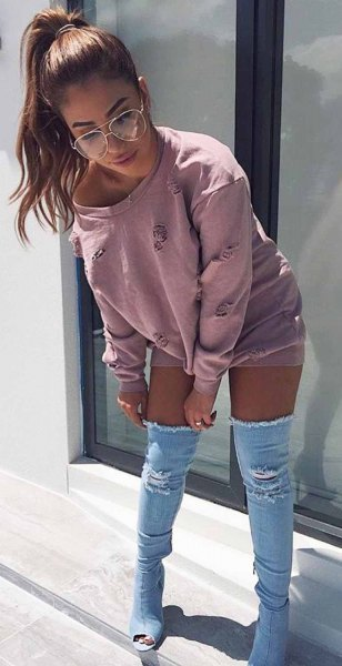 gray sweat-style dress with a boat neckline and thigh-high denim boots with open toes