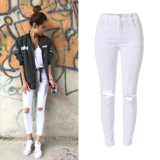 gray bomber jacket with short white skinny jeans with a high waist