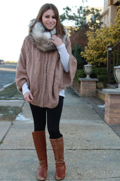 gray knitted sweater with cable pattern and infinity scarf made of faux fur