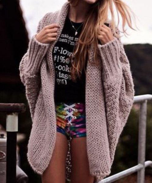 gray cable knit cardigan over t-shirt mini shorts