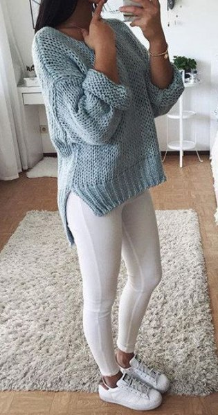 gray, chunky knitted sweater with leggings and sneakers