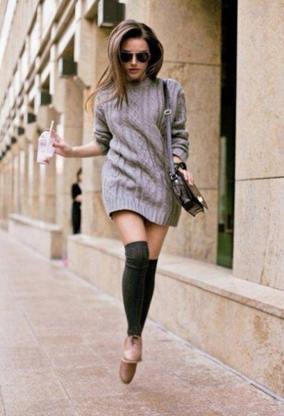 gray knitted sweater dress with black stockings