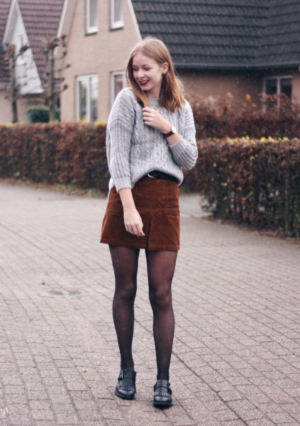 gray cable knit sweater with deep brown mini skirt