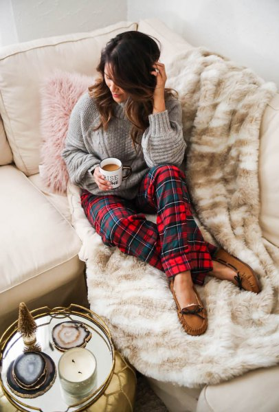 gray cable knit sweater with red and blue checked pajama pants