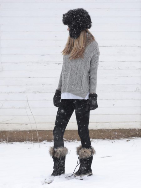 gray cable knit sweater with white shirt with buttons and snowshoes made of faux fur