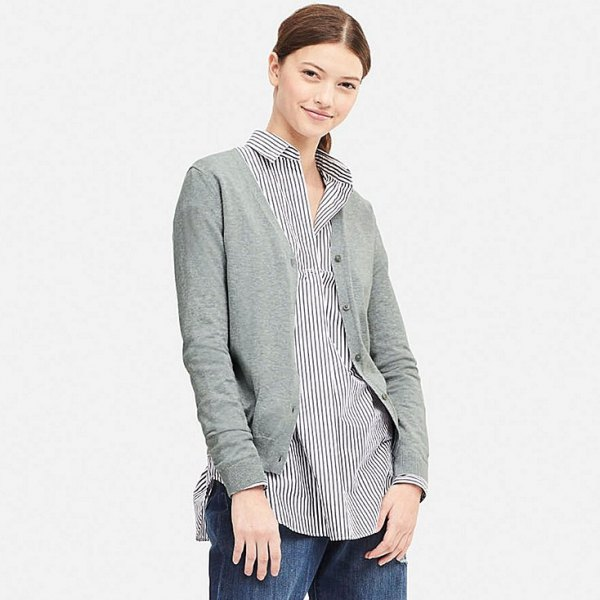 gray cardigan with a black and white striped shirt with buttons