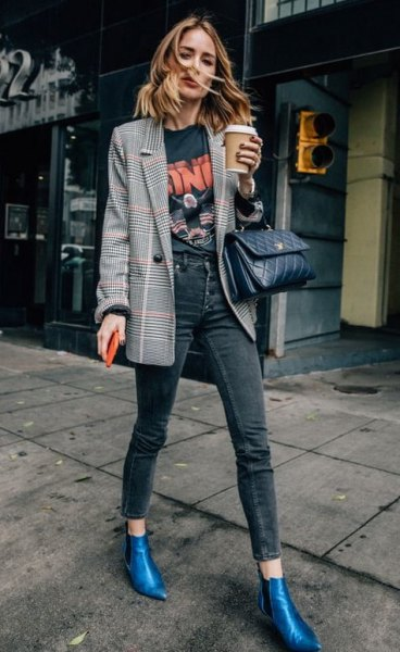 gray checked blazer with black printed t-shirt and blue leather boots