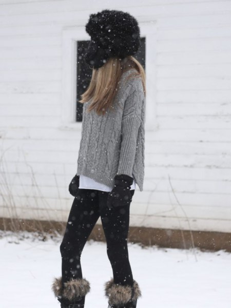 gray, coarse-grained knitted sweater with knee-high boots made of faux fur