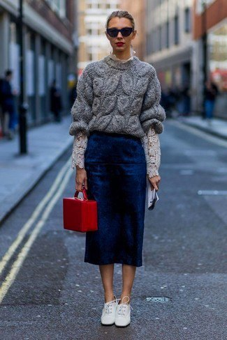gray, chunky sweater with dark blue midi skirt and white leather shoes