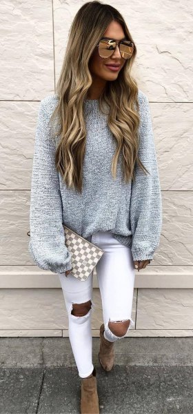 gray, chunky sweater with white, heavily torn skinny jeans