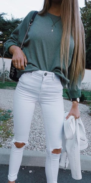 gray, chunky sweater with white, ripped skinny jeans