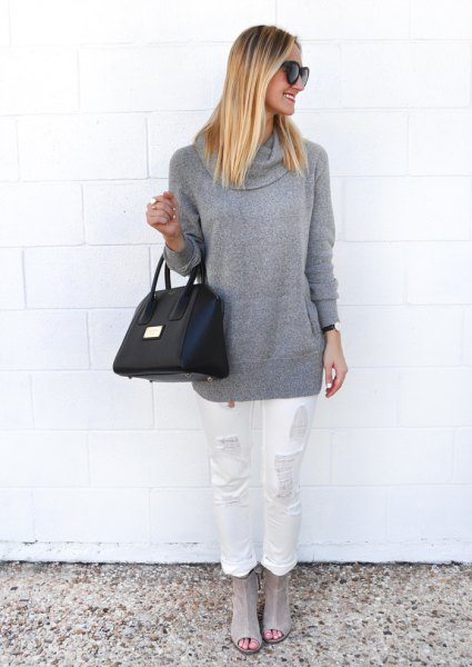 gray chunky sweater with white straight-leg jeans