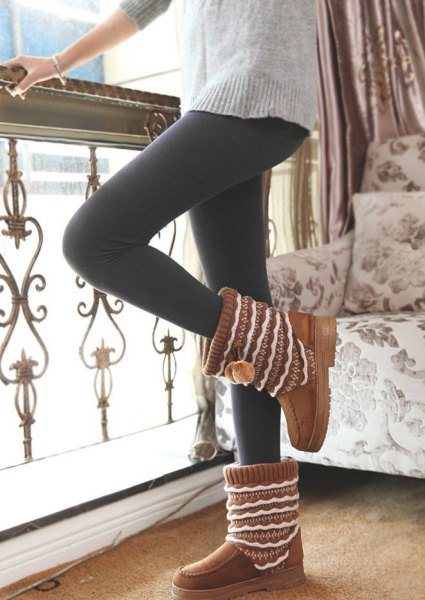 gray, chunky tunic sweater with black leggings and brown ankle boots