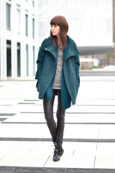 gray cocoon coat with blue chambray longline shirt and leather gaiters