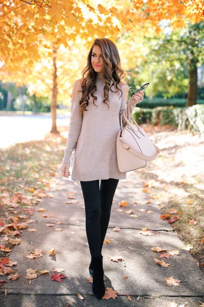 gray tunic sweater with cold shoulder and black leather leggings