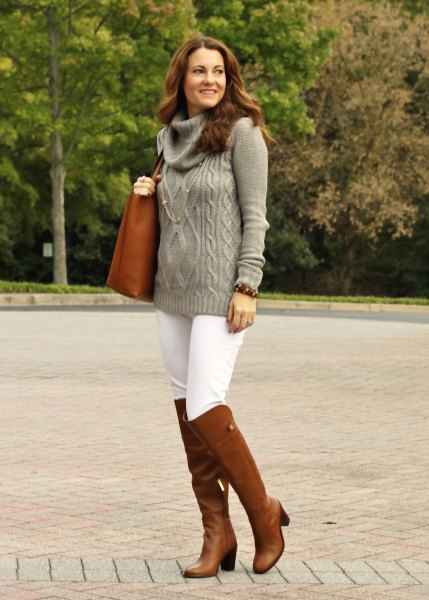 gray cable knit sweater with a waterfall neckline, white skinny jeans and brown boots
