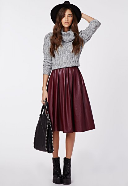 Short knitted sweater with gray waterfall neckline and flared skirt made of midi silk