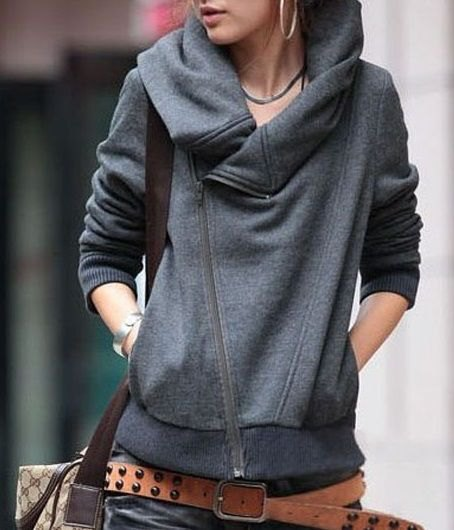 gray hooded sweater with hooded neckline, jeans and studded belt
