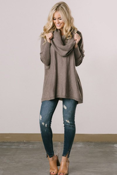 gray, ribbed sweater dress with a waterfall neckline and blue ribbed skinny jeans