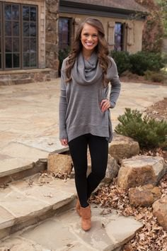 gray sweater with cowl neckline, black leggings and camel ankle boots